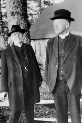 Bishop Crimont, S.J., D.D. and Father William G. LeVasseur, S.J. next to the Shrine Chapel