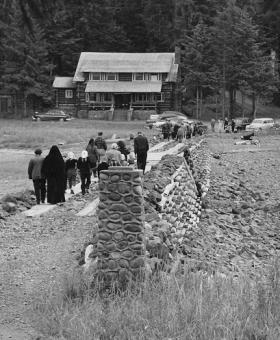 Walking across the causeway from the Chapel toward the lodge, 1940's